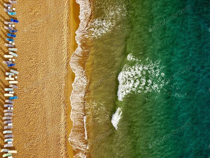 Top view of the beach and sun loungers. The deserted coast of th