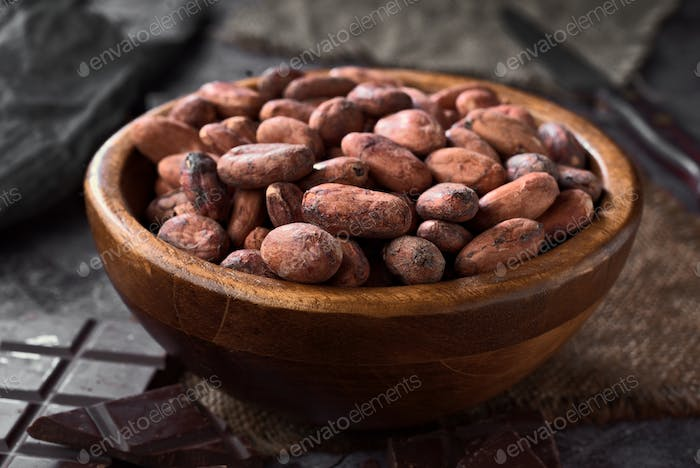 wooden bowl filled with cocoa beans