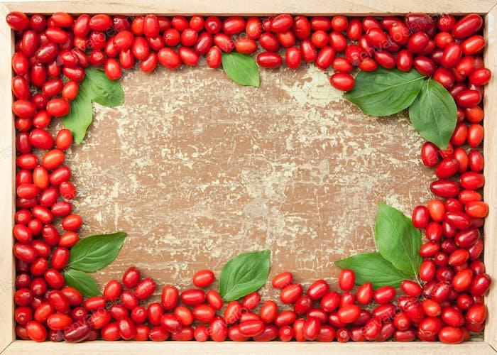 Cornelian cherries in wooden frame