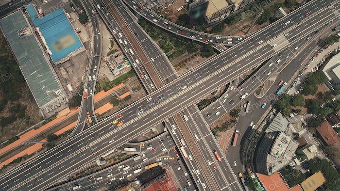 Cross highway top down at Philippines cityscape aerial. Cars, buses, vans, trucks at traffic road