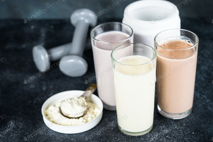 Protein cocktails and dumbbells, sport and fitness concept.