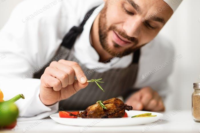 Cook Man Decorating Chicken Dish Preparing Dinner In Kitchen Indoor
