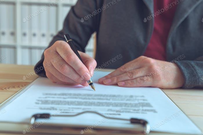 Businesswoman signing contract and business partnership agreemen