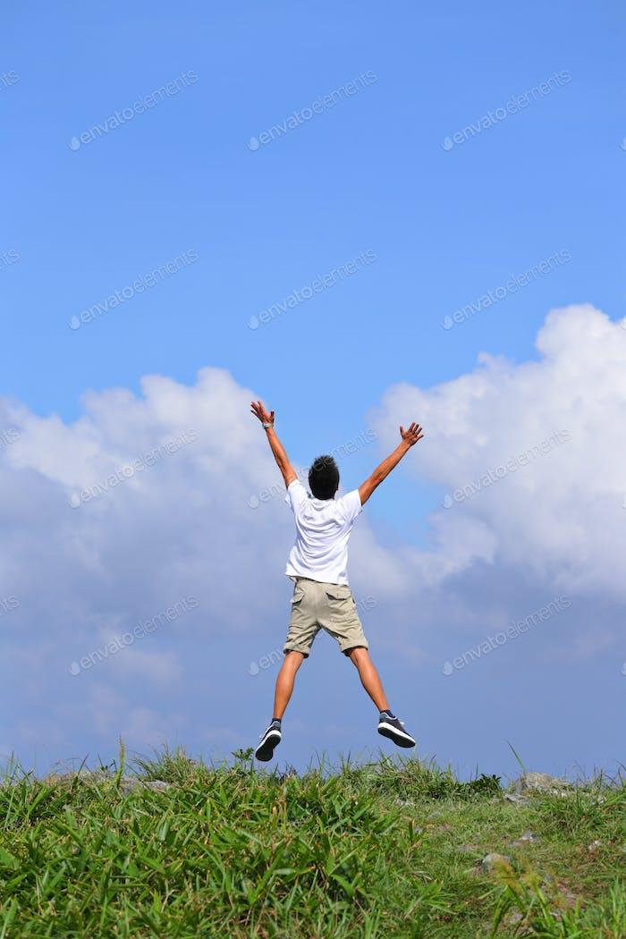 happy man jump freely