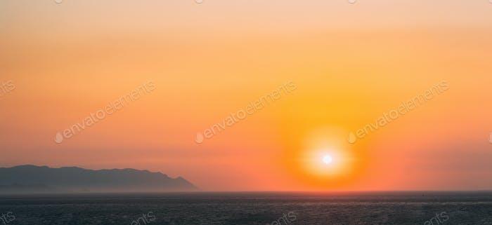 Aegean Sea. Evening Sun Sunshine Above Sea. Natural Sunset Sky Warm Colors. Panorama, Panoramic View