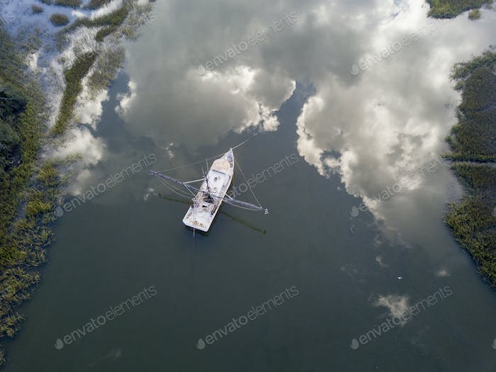 Aerial view of shrimp boat in South Carolina with perfect reflec