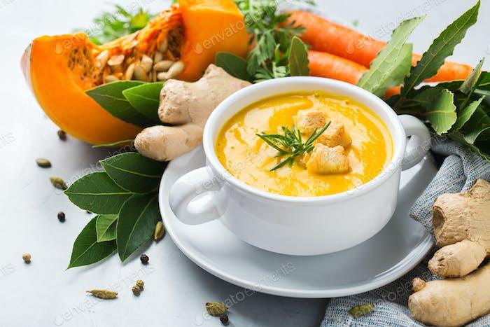 Seasonal spicy fall autumn creamy pumpkin and carrot soup