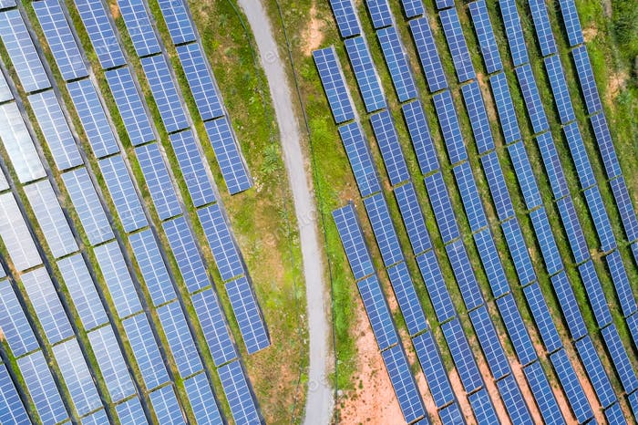 aerial view of photovoltaic panels on hillside
