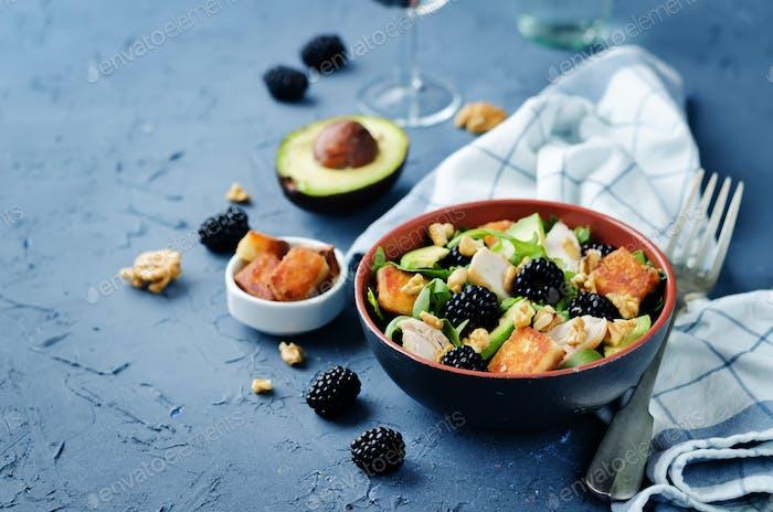Crispy goat cheese blackberry arugula chicken avocado salad