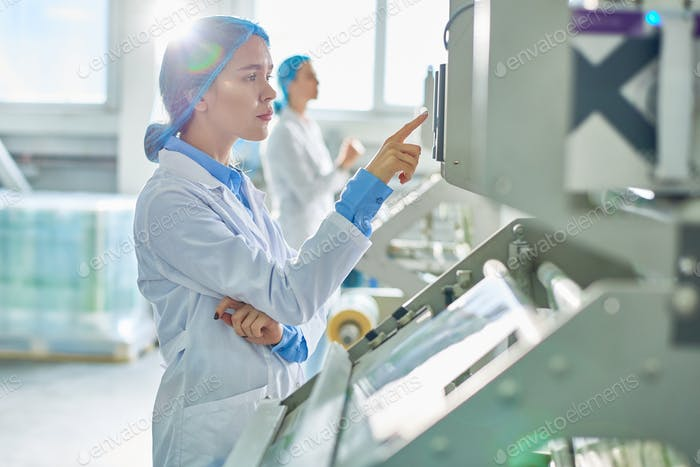 Female Worker at Modern Factory