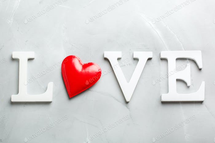Valentines day holiday text word love with red heart