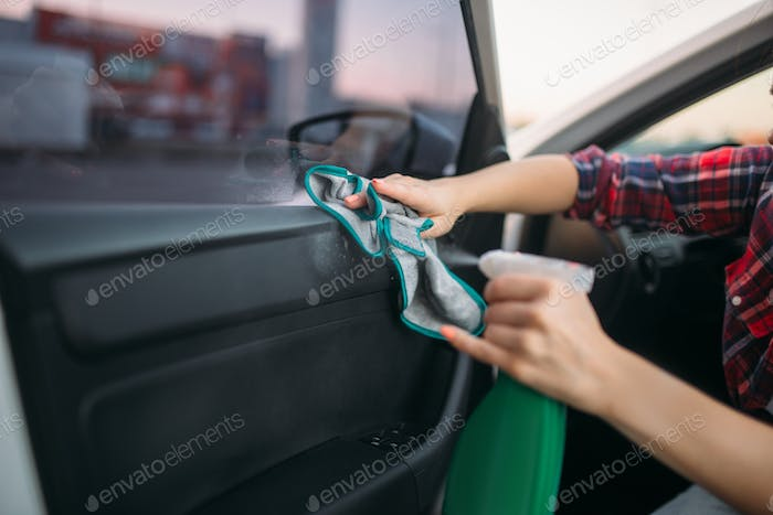 Wet cleaning of the interior of car on carwash
