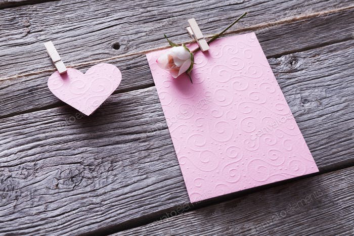 Valentine day, card and paper heart on wood background