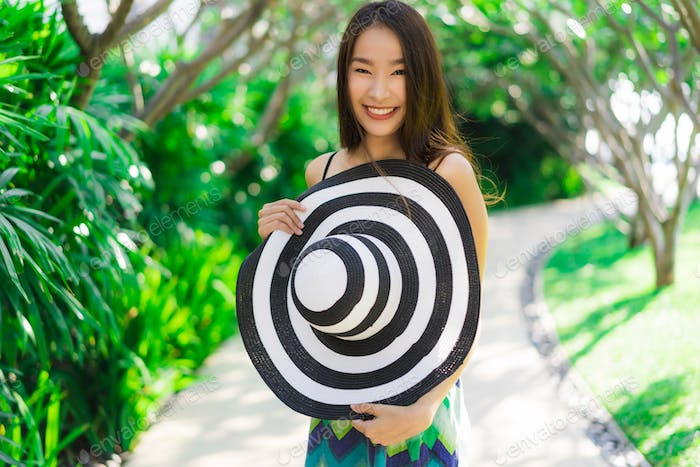 Portrait beautiful young asian woman smile and happy around outd