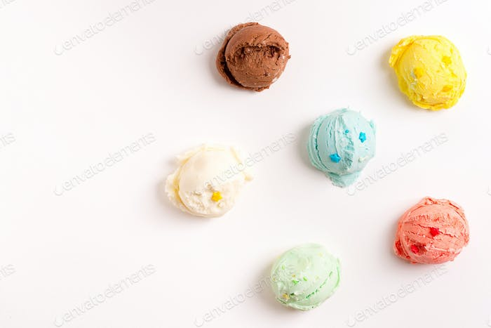 Colorful balls from freshly cooked homemade sweet ice-cream or gelato on a white background
