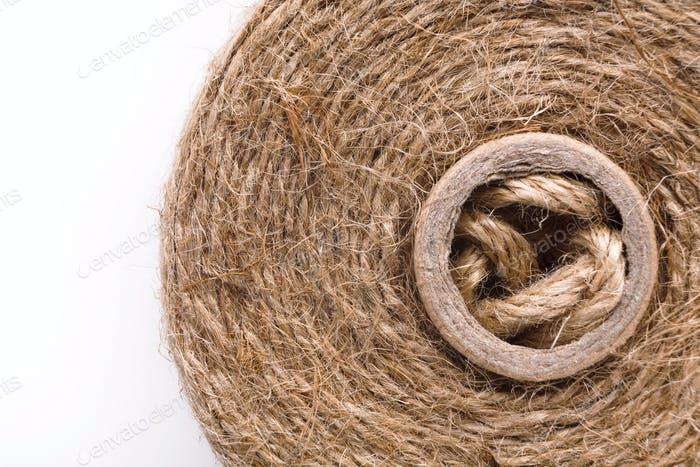 Coil of natural rope on white background