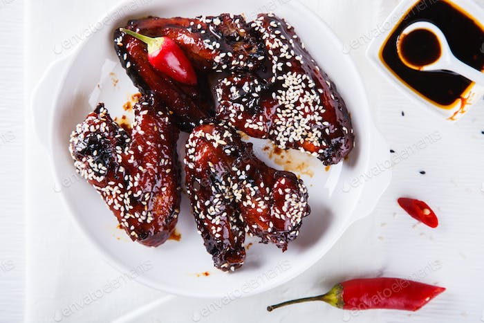 Chicken wings in soy sauce and sesame seeds