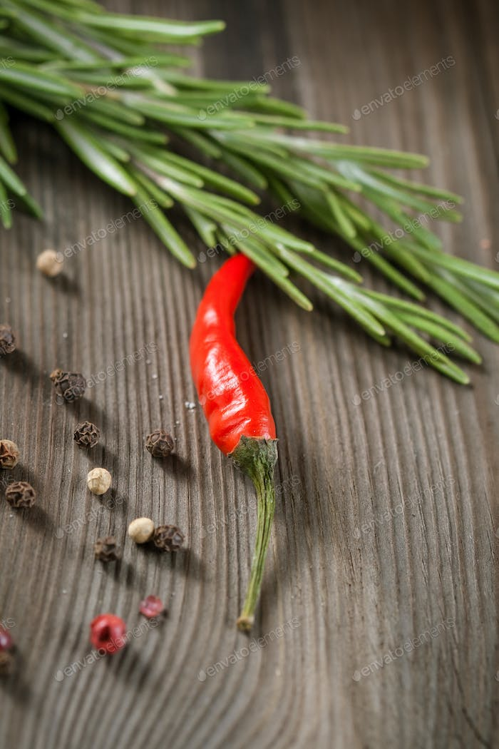 Rosemary and red hot chili pepper in a mortar