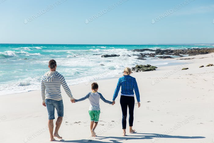 Parents and son at the beach
