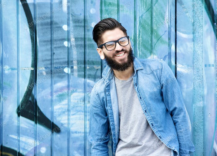 Man with beard and glasses laughing