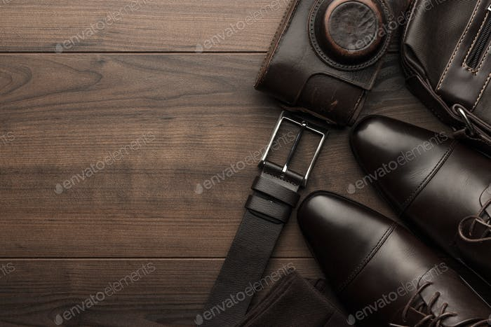 Brown Shoes, Belt, Socks And Film Camera