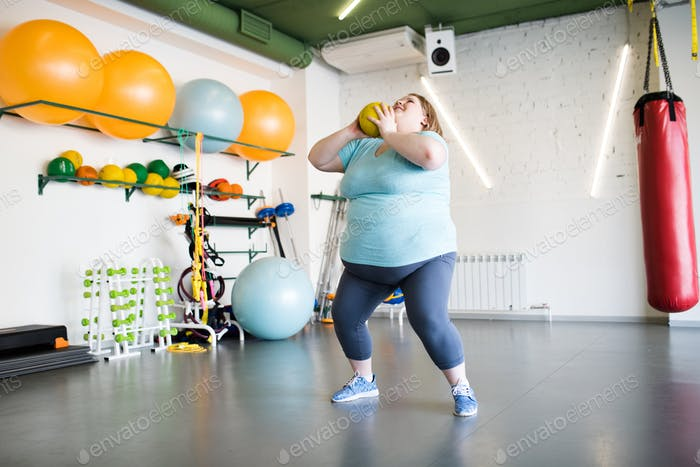 Overweight Woman Doing Squats
