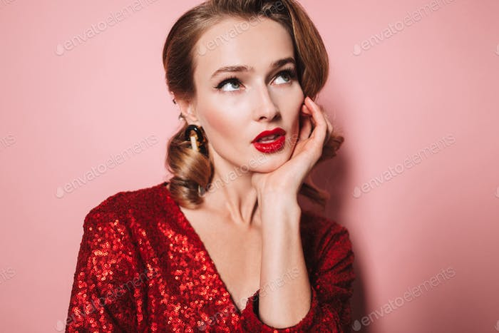 Close up young beautiful woman with wavy hairstyle and red lips