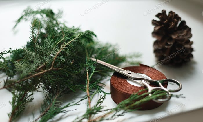 Christmas present wrapping on white wood background