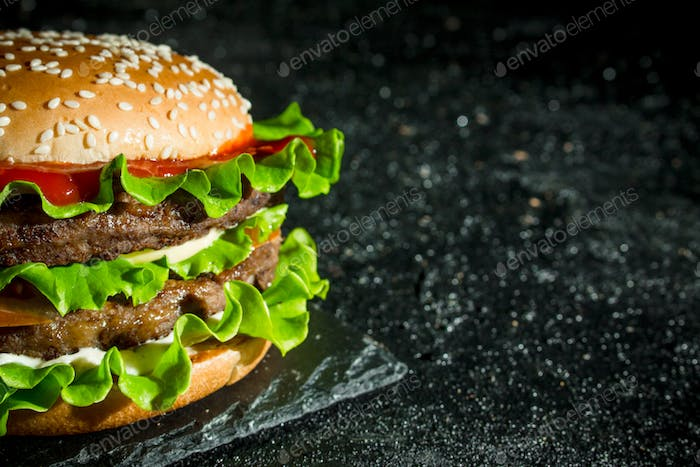 Burger with beef and vegetables.