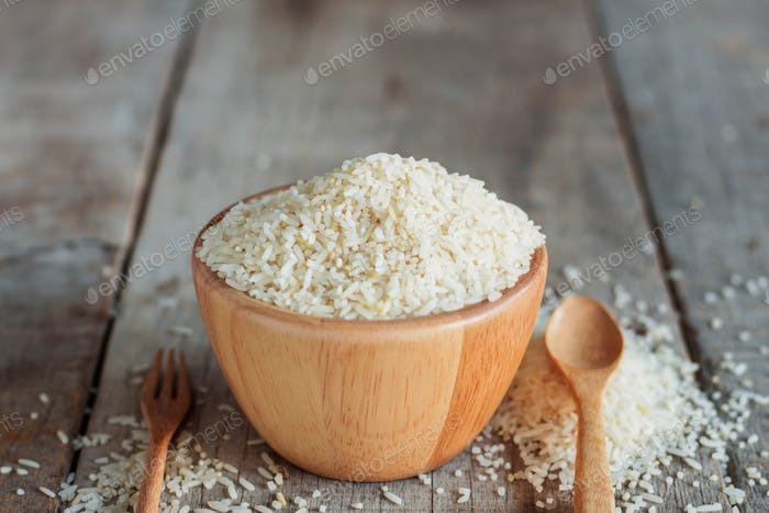 Rice and spoon on wooden