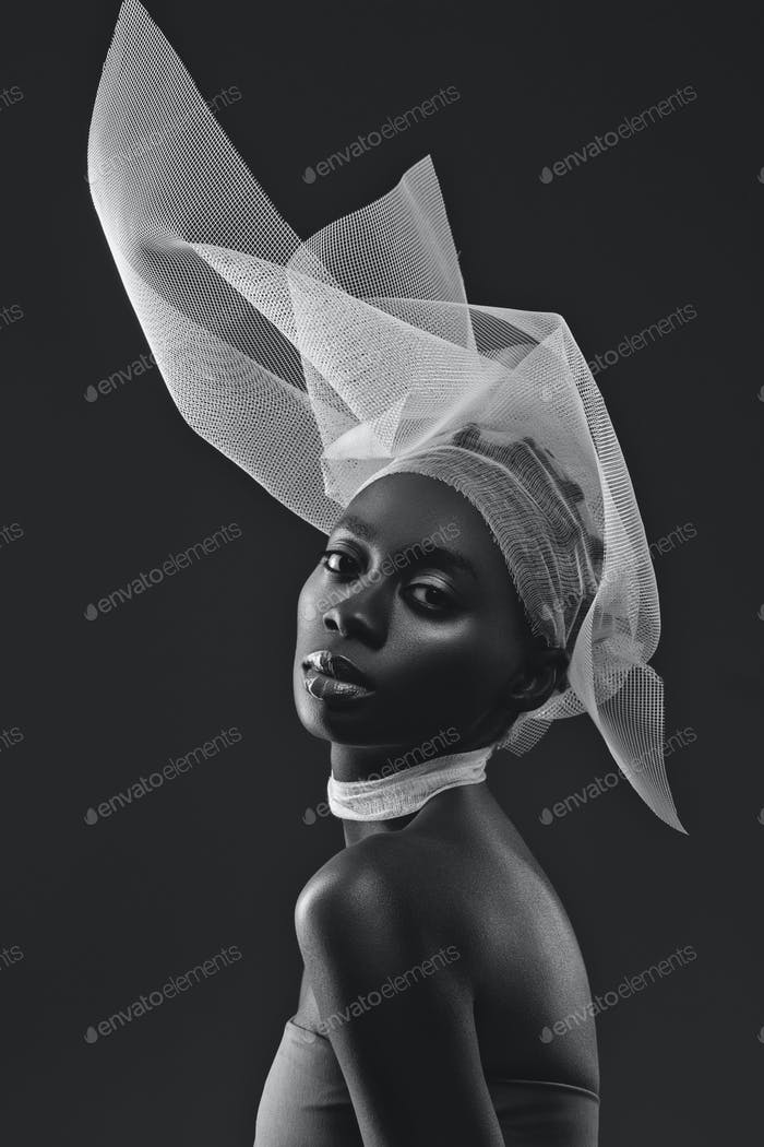 Beautiful african girl with veil hat