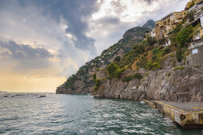 Cliff coast in Positano town at sunset