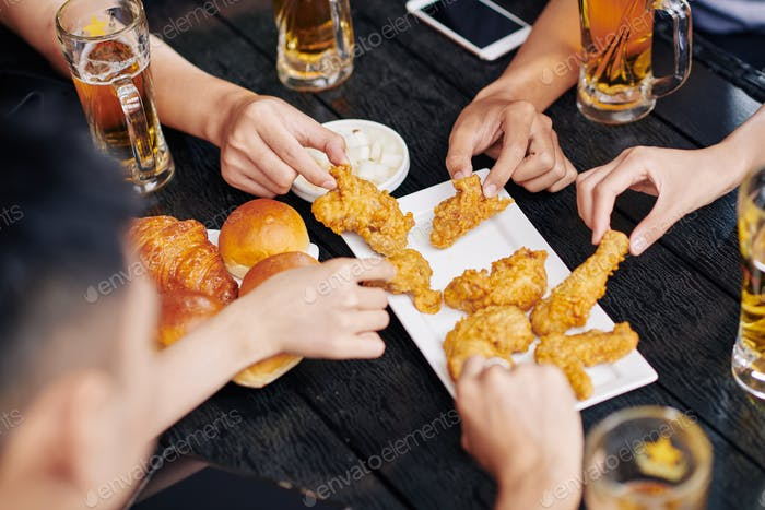 People eating fried chicken