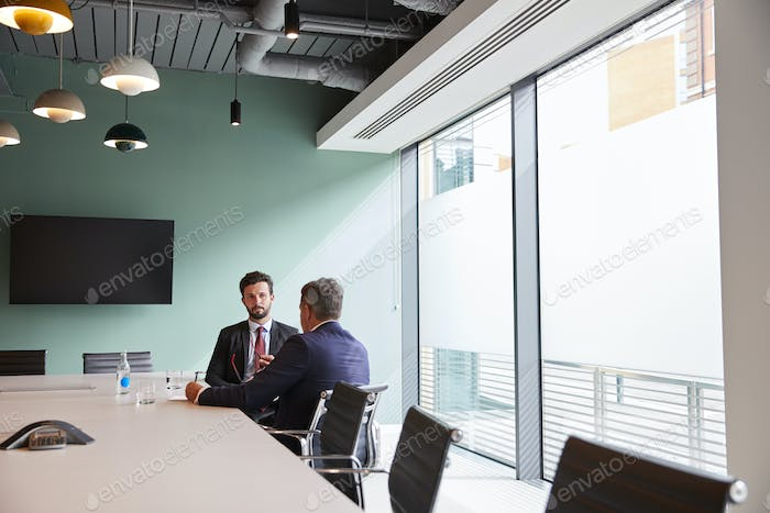 Businessman Interviewing Male Candidate At Graduate Recruitment Assessment Day In Office