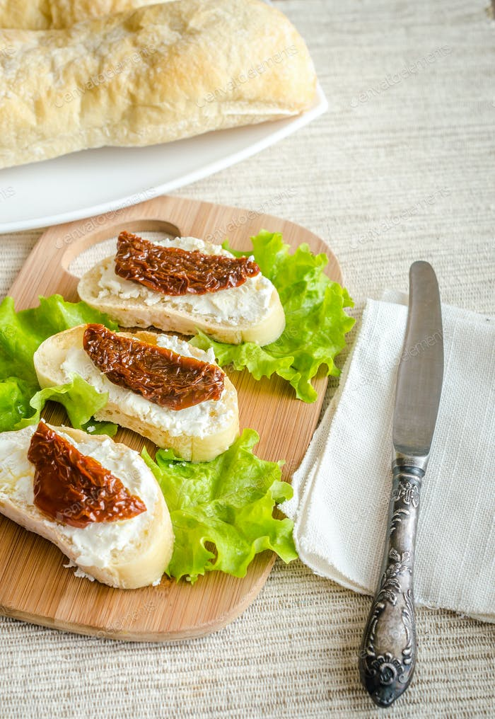 Ciabatta sandwiches with cottage cheese and sun-dried tomatoes