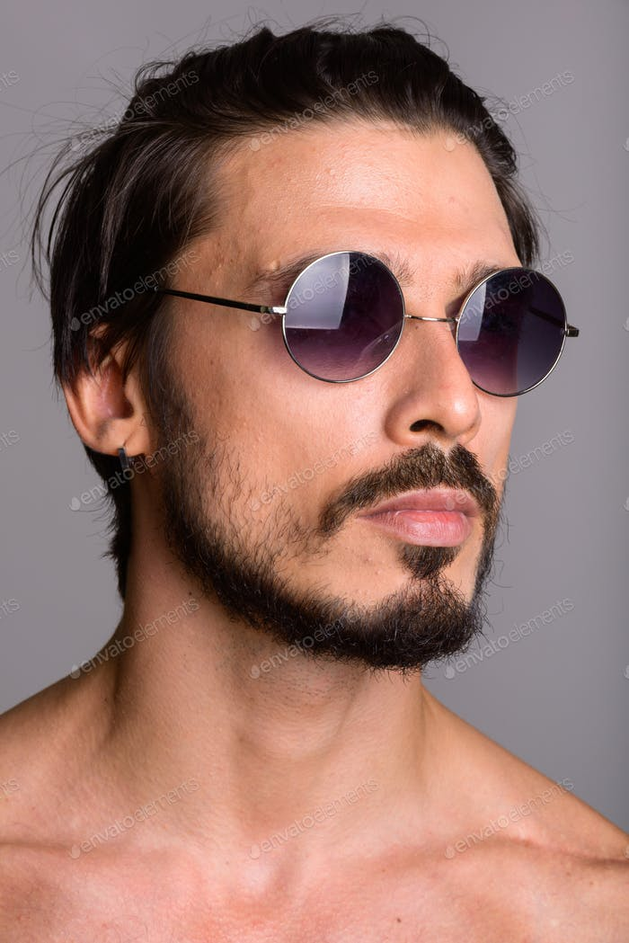 Face of handsome man thinking with sunglasses