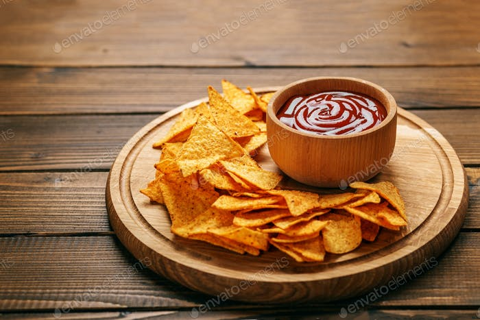 Mexican Nachos Chips with Barbecue Sauce. Concept - bad food, ca