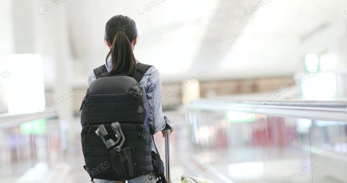 Backpacker go for a trip in the airport