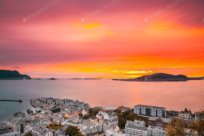 Alesund, Norway. Amazing Natural Bright Dramatic Sky In Warm Colours Above Alesund Valderoya And