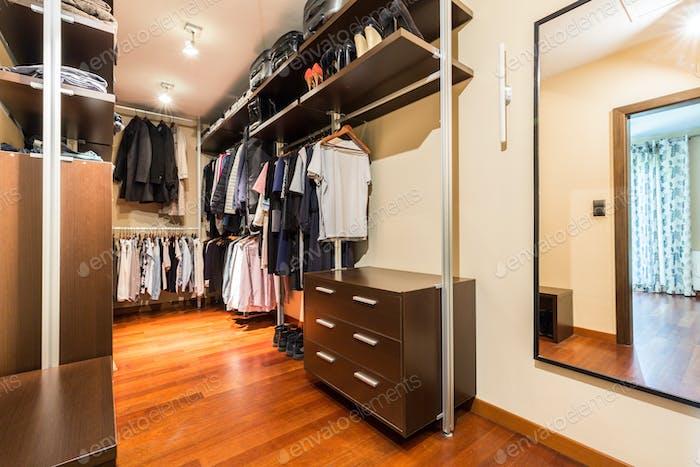 Walk-in closet with wooden wardrobes