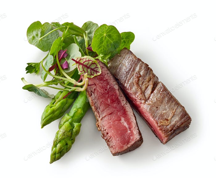 beef wagyu steak meat with herbs and asparagus isolated on wight background