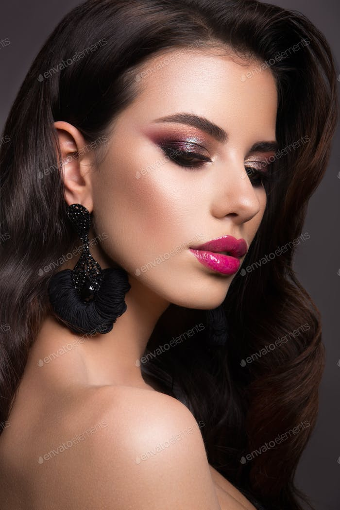 Beautiful woman with professional make up. Pink lips
