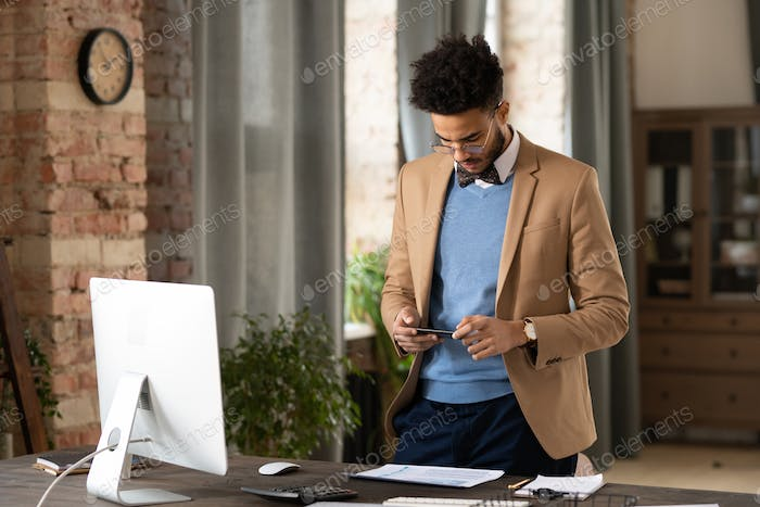 Fashionable businessman photographing papers