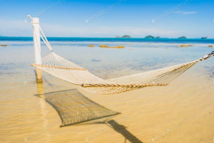 Beautiful empty hammock around tropical beach sea ocean for holi
