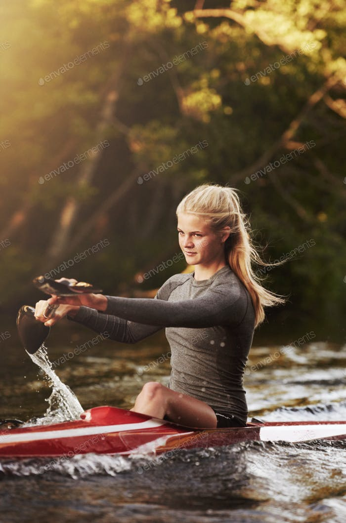 Athletic woman kayaking
