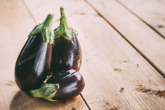 Healthy Organic Vegetables Two Eggplants On A Wooden Table