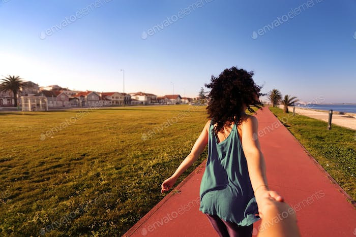 Woman walking in the city park