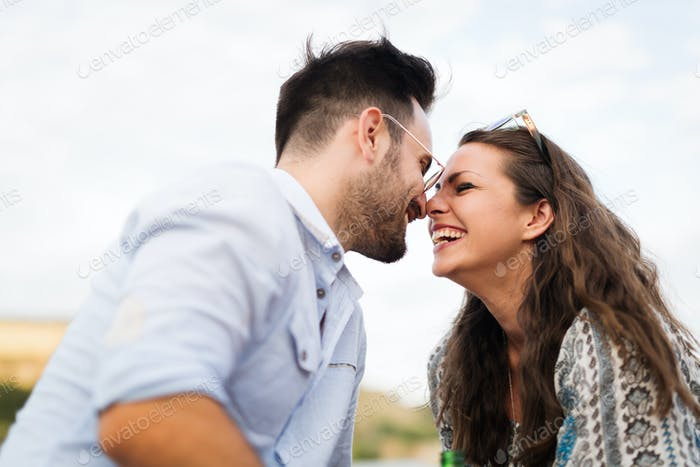 Young attractive happy couple having romantic date