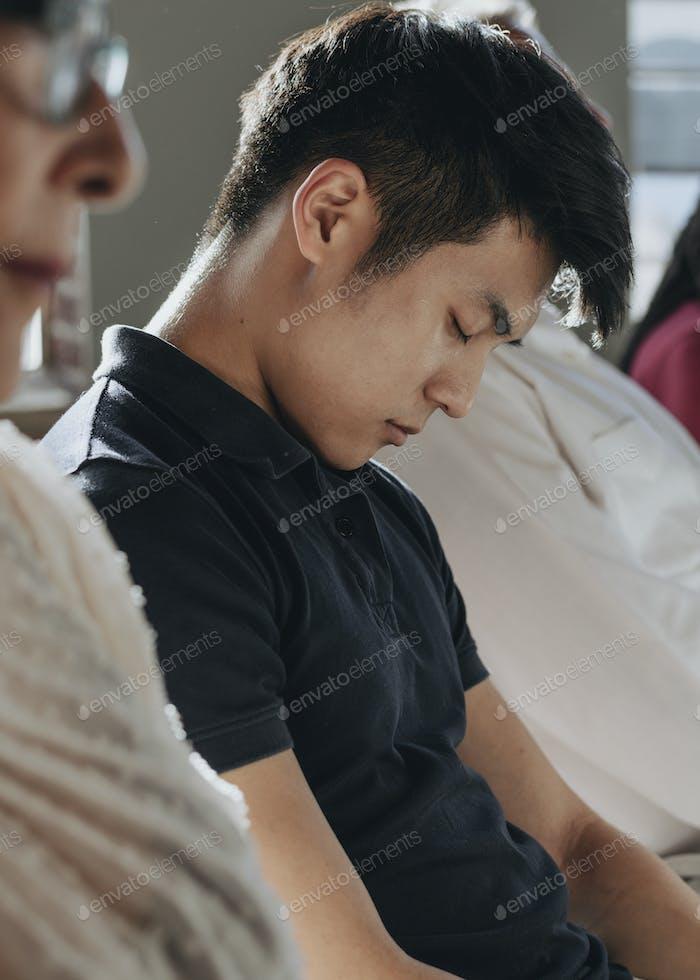 Bored man sleeping in seminar