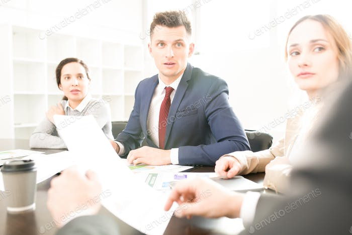 Business employees listening to boss